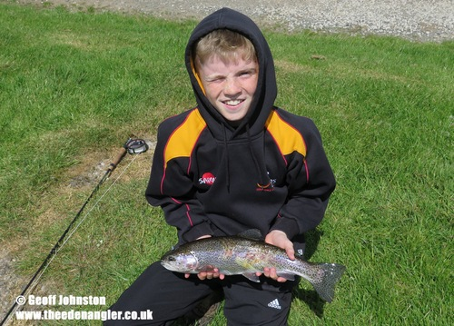 Sam with his first fish on the fly
