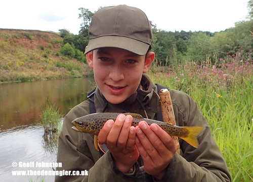 13 year-old Eben with a fish for the camera before it was safely returned