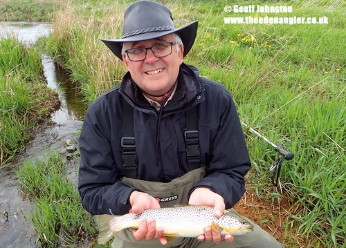 Colin with a fish during a Grannom hatch