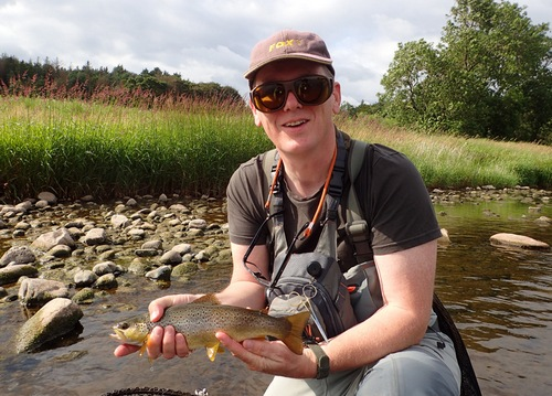 Mark with a fish on his first visit to Eden