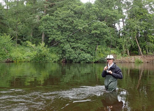 Colum into his first river trout
