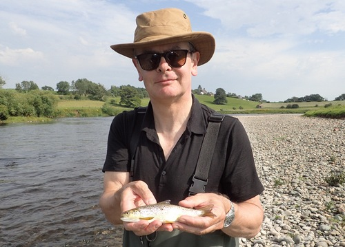 Robert with his first trout on the fly!