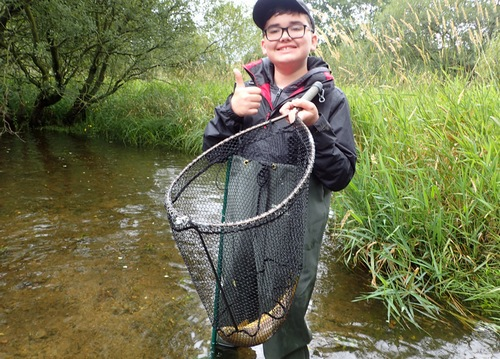 Oli has a trout in the net