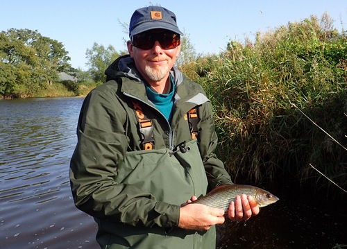 Steve with his first grayling on the fly